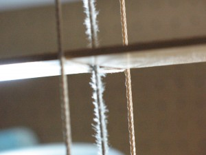 wood blind with frayed string